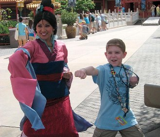 By supporting educational efforts at KFA you have enabled Daniel and his family to enjoy their Disney vacation without fear! Here he is teaching Mulan a front punch!